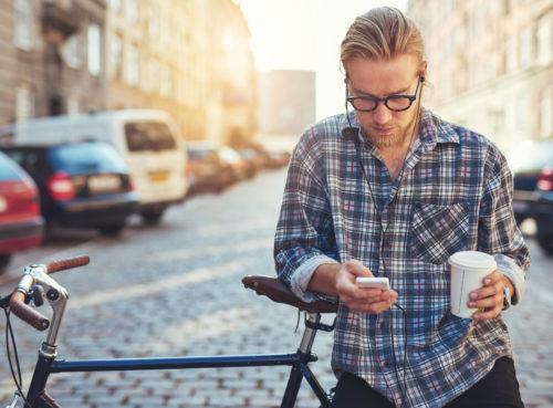 man on bike, with phone